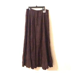 Long brown skirt, with brown lace string ties.